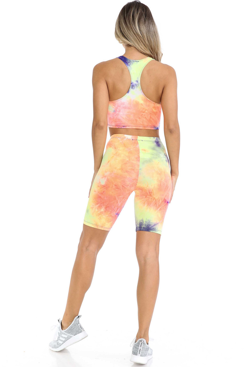Back view of Indigo Tie Dye 2 Piece Shorts and Cropped Bra Top Set shown styled with light gray sneakers.