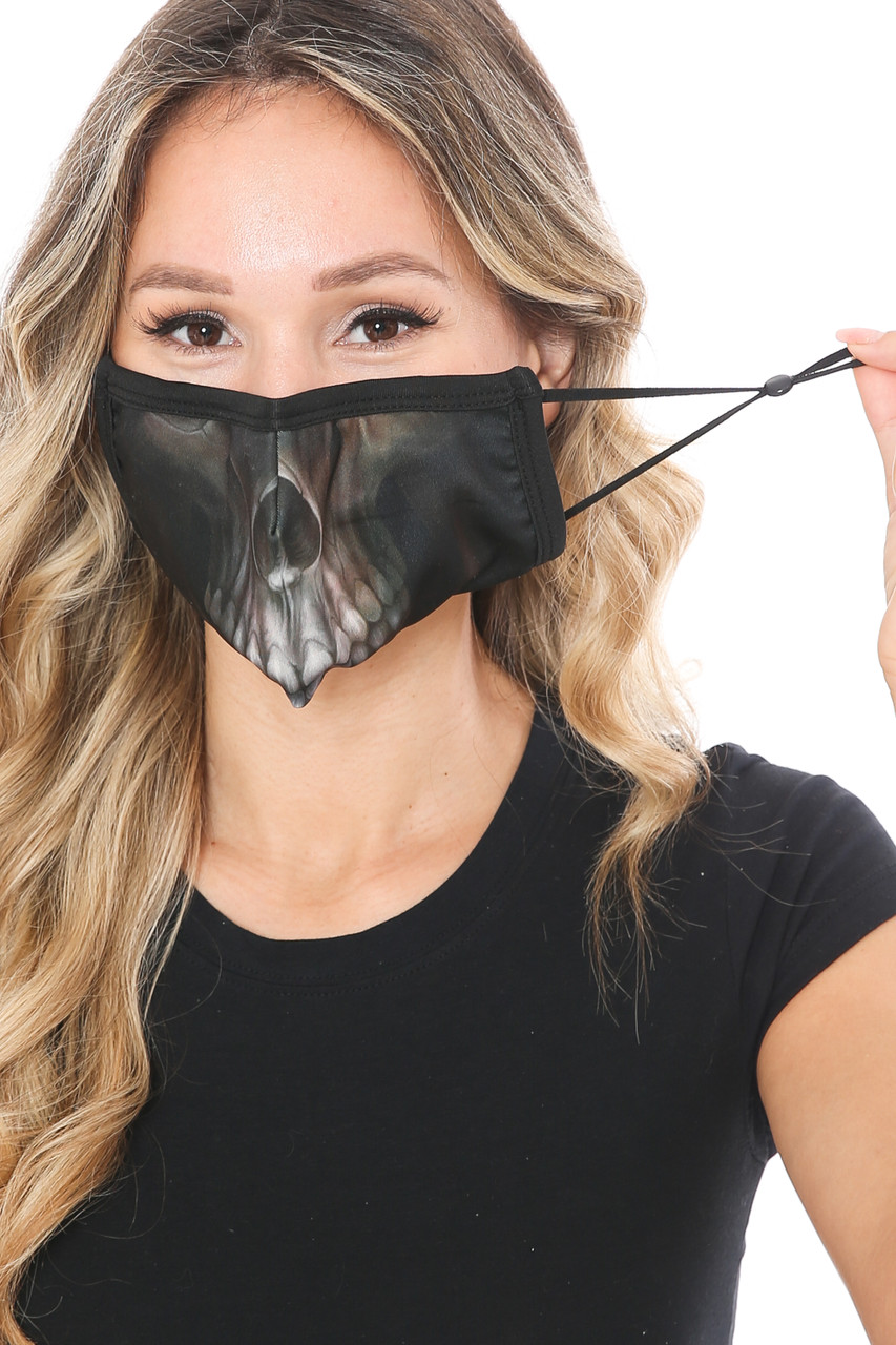 Front view of Dark Skull Graphic Print Face Mask with adjustable ear strings.
