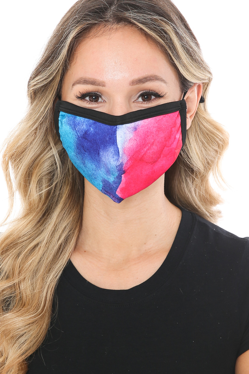 Front view of Split Tie Dye Graphic Print Fashion Face Mask with a half fuchsia half blue  design.