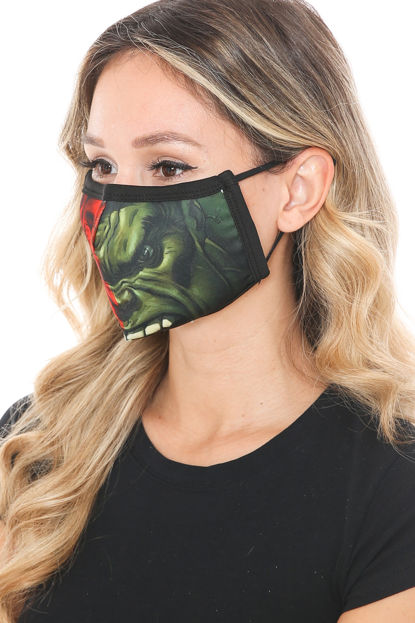 Left side view of Split Hulk Graphic Print Face Mask showing the green side of the design.