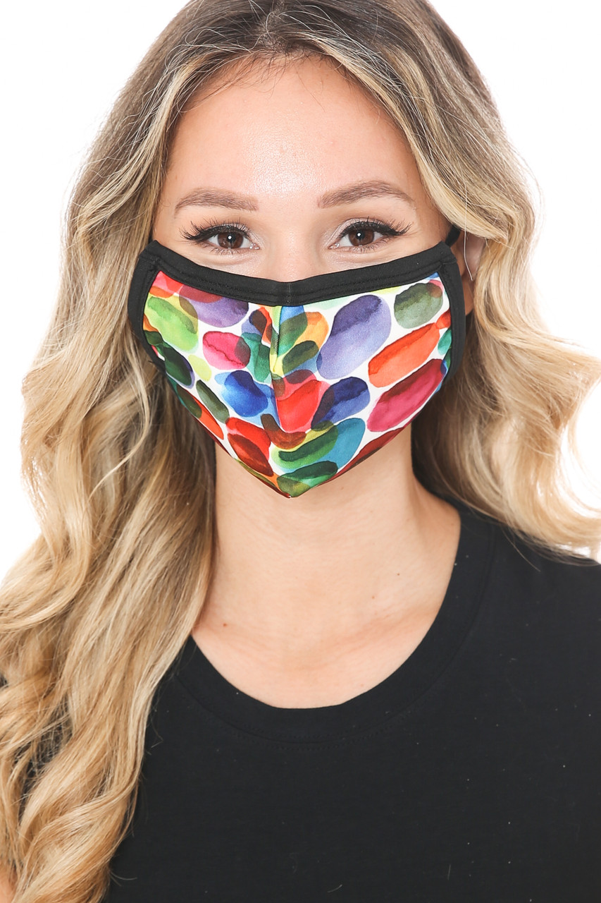 Front view of Rainbow Watercolor Graphic Print Face Mask showcasing a colorful paint splashed design.