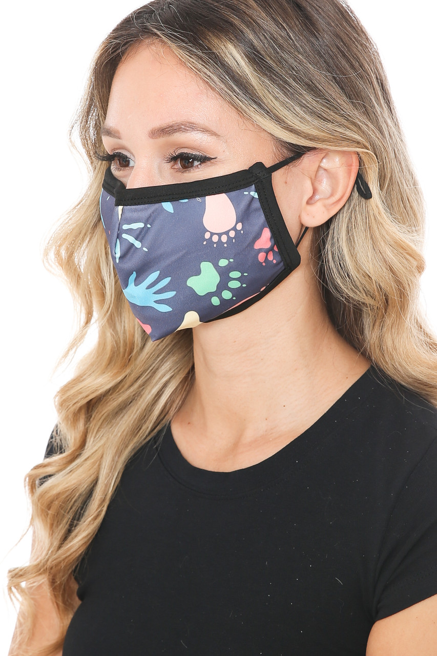 Left side view of Animal Tracks Graphic Print Face Mask