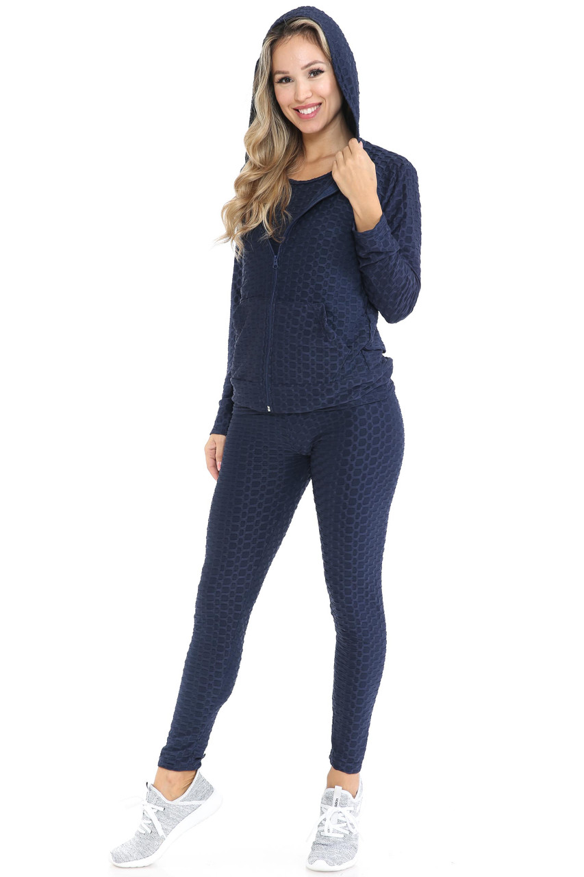 45 degree view of Navy 3 Piece Scrunch Butt Leggings Tank Top and Hooded Jacket Set shown with hoodie up