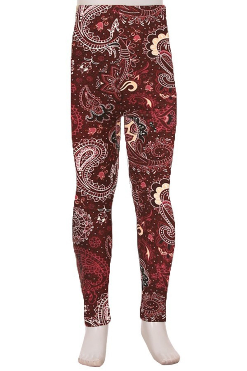 Front view image of Buttery Soft Gorgeous Jumbo Paisley Kids Leggings with a white and beige paisley design on a burgundy background.