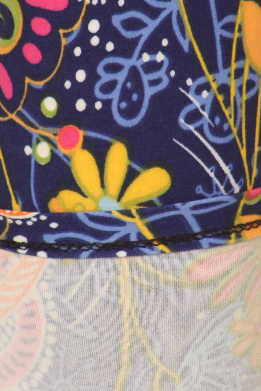 Close up swatch of Buttery Soft Dazzling Rainbow Paisley Plus Size Leggings