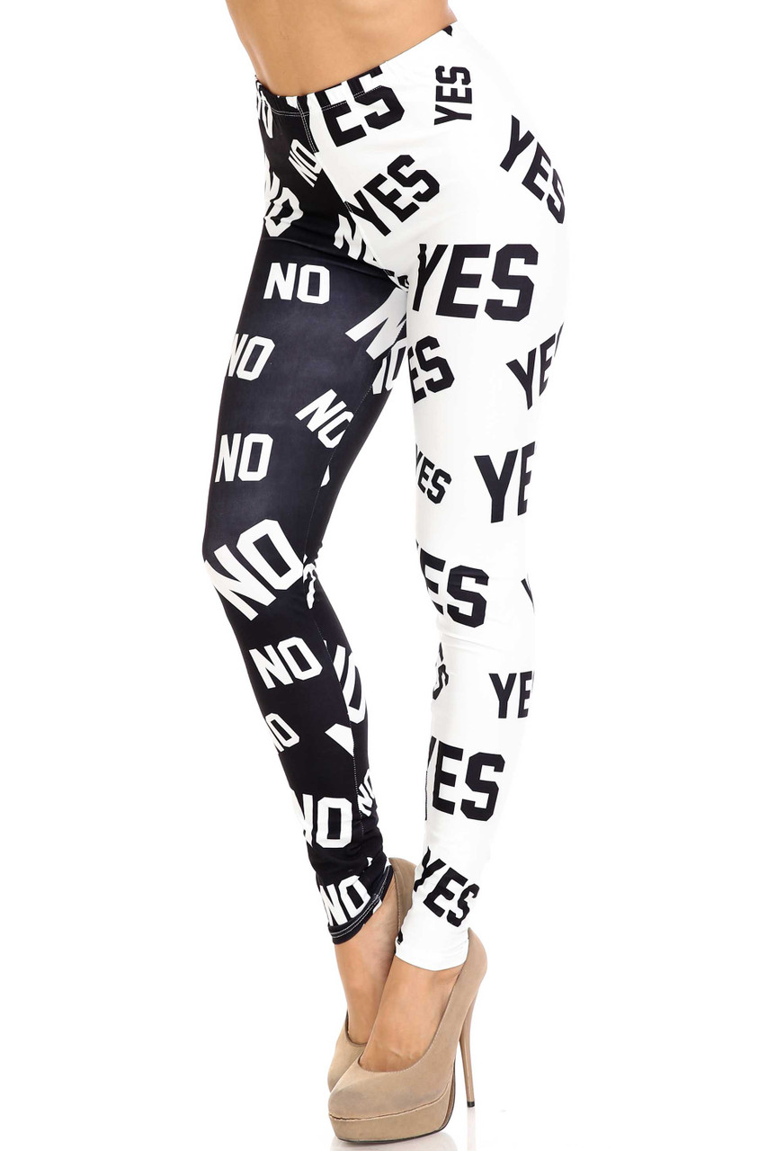 """45 degree view of Creamy Soft Yes and No Plus Size Leggings - By USA Fashion™ with a split black and white design, one leg printed with """"yes"""" and  """"no"""" on the other in a repeating pattern"""