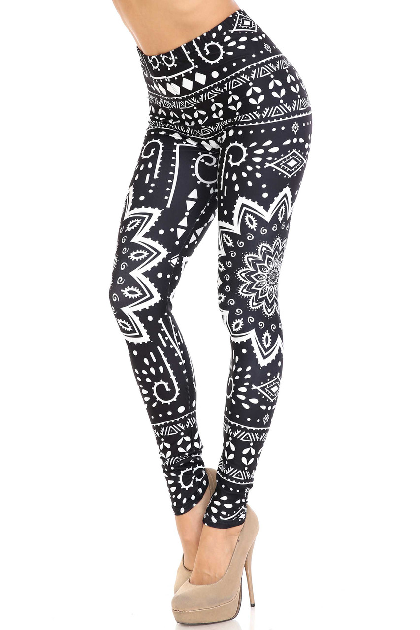 45 degree view of Creamy Soft Black Tribal Mandala Plus Size Leggings - By USA Fashion™ with an eye-catching high contrast white on black tribal design.