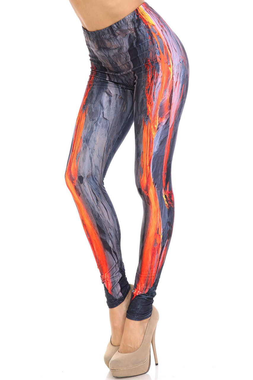 45 degree view of Creamy Soft Hot Lava Leggings -  By USA Fashion™ with a bright orange vertical magma design and gray volcanic rock.