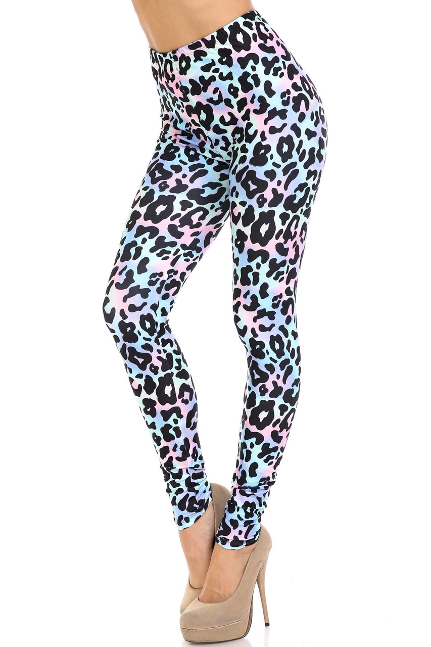 45 degree view of Creamy Soft Chromatic Leopard Leggings - By USA Fashion™ with a black spotted animal print design on a pastel multi colored background.