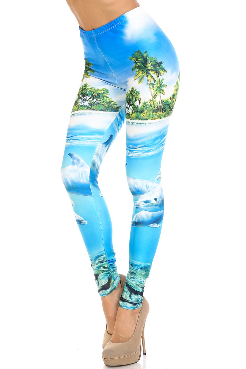 45 degree view of Creamy Soft Dolphin Paradise Plus Size Leggings - By USA Fashion™ with a stunning ocean and sea life design.