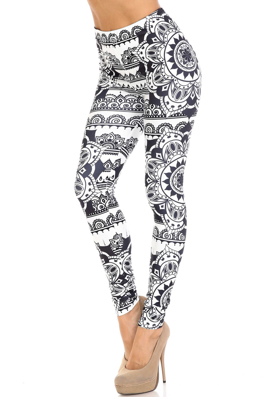 45 degree view of Creamy Soft Monochrome Mandala Extra Plus Size Leggings - 3X-5X - By USA Fashion™ with a decorative black and white design.