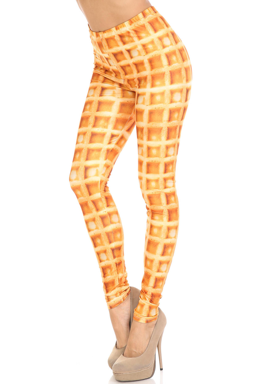 45 degree view of Creamy Soft Waffle Plus Size Leggings - By USA Fashion™ with a realistic all over breakfast waffle print.