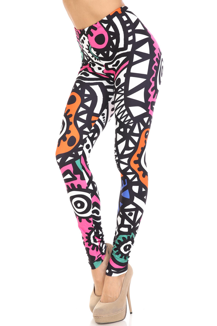 45 degree view of Creamy Soft Color Tribe Plus Size Leggings  - By USA Fashion™ with a retro 90s style tribal design with black and white and pops of color.