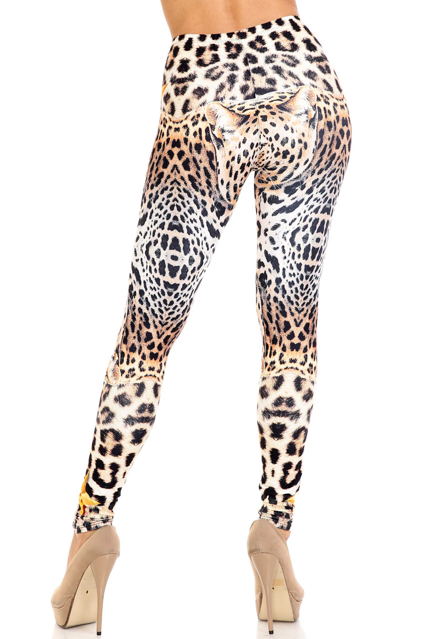 Rear view of Creamy Soft Leopard Star Plus Size Leggings - USA Fashion™ showing a spotted beige, brown, and black animal print design.
