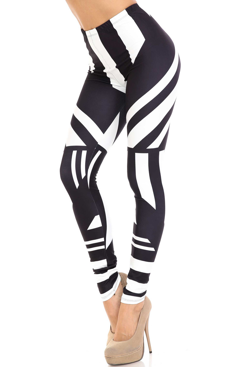 45 degree view of Creamy Soft Body Flatter Lines Extra Plus Size Leggings - 3X-5X - USA Fashion™ with a contouring linear design.