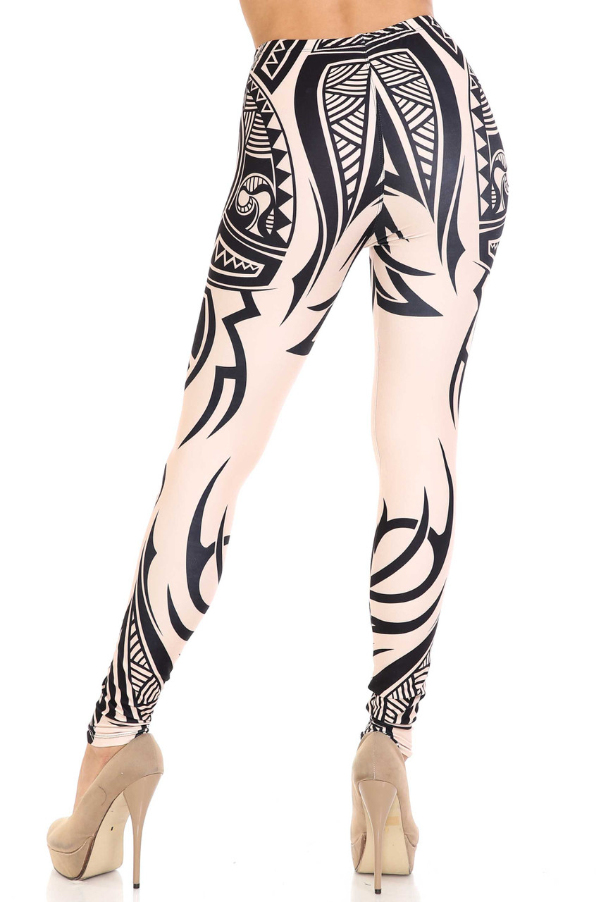 Back side view of Creamy Soft Celestial Tribal Plus Size Leggings - USA Fashion™ with a full length skinny leg hem.