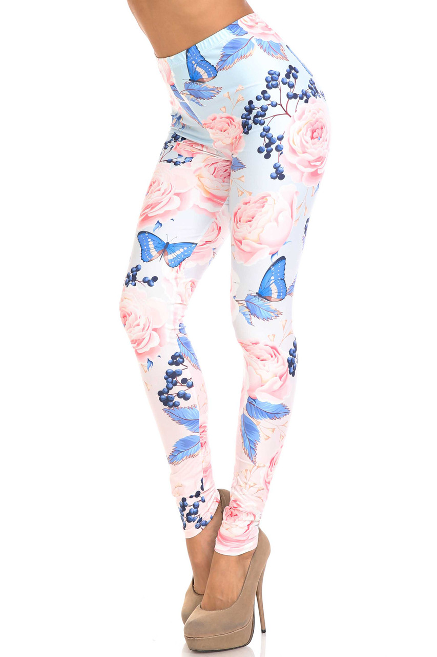 45 degree view of Creamy Soft Butterflies and Jumbo Pink Roses Leggings - USA Fashion™ featuring a soft pink and blue floral and butterfly design.