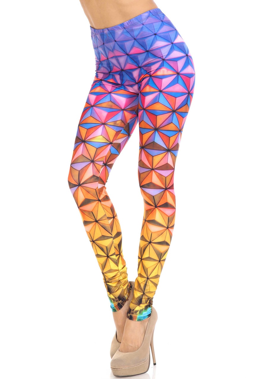 45 degree view of Creamy Soft Ombre Epcot Leggings - USA Fashion™ with a fabulous eye-catching 3D ombre pyramid design with a blue, pink, orange, and yellow design.