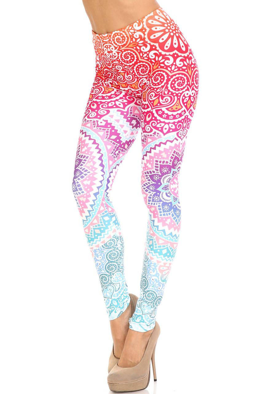 45 degree view of Creamy Soft Ombre Mandala Aztec Leggings - USA Fashion™ featuring a fabulous orange, pink, purple, and blue fabric design.