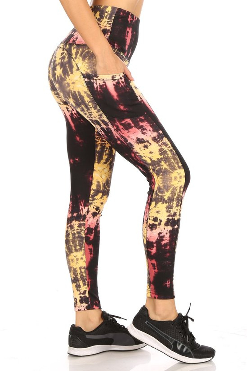 Right side view of High Waisted Sunshine Tie Dye Sports Leggings with Side Pockets with a yellow and burgundy fabric design.