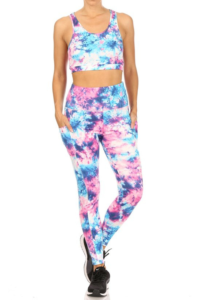 Front view of High Waisted Daffodil Tie Dye Sports Leggings and Crop Top - 2 Piece Set with a colorful pink, purple, and blue tie dye design.