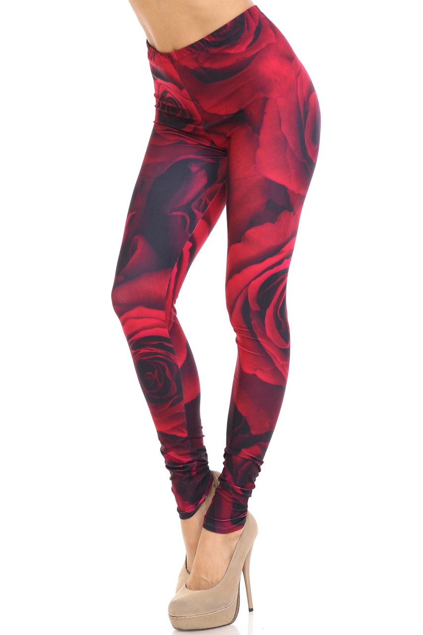 45 degree view of Creamy Soft Jumbo Red Rose Leggings - USA Fashion™ featuring a stunning red rose design.