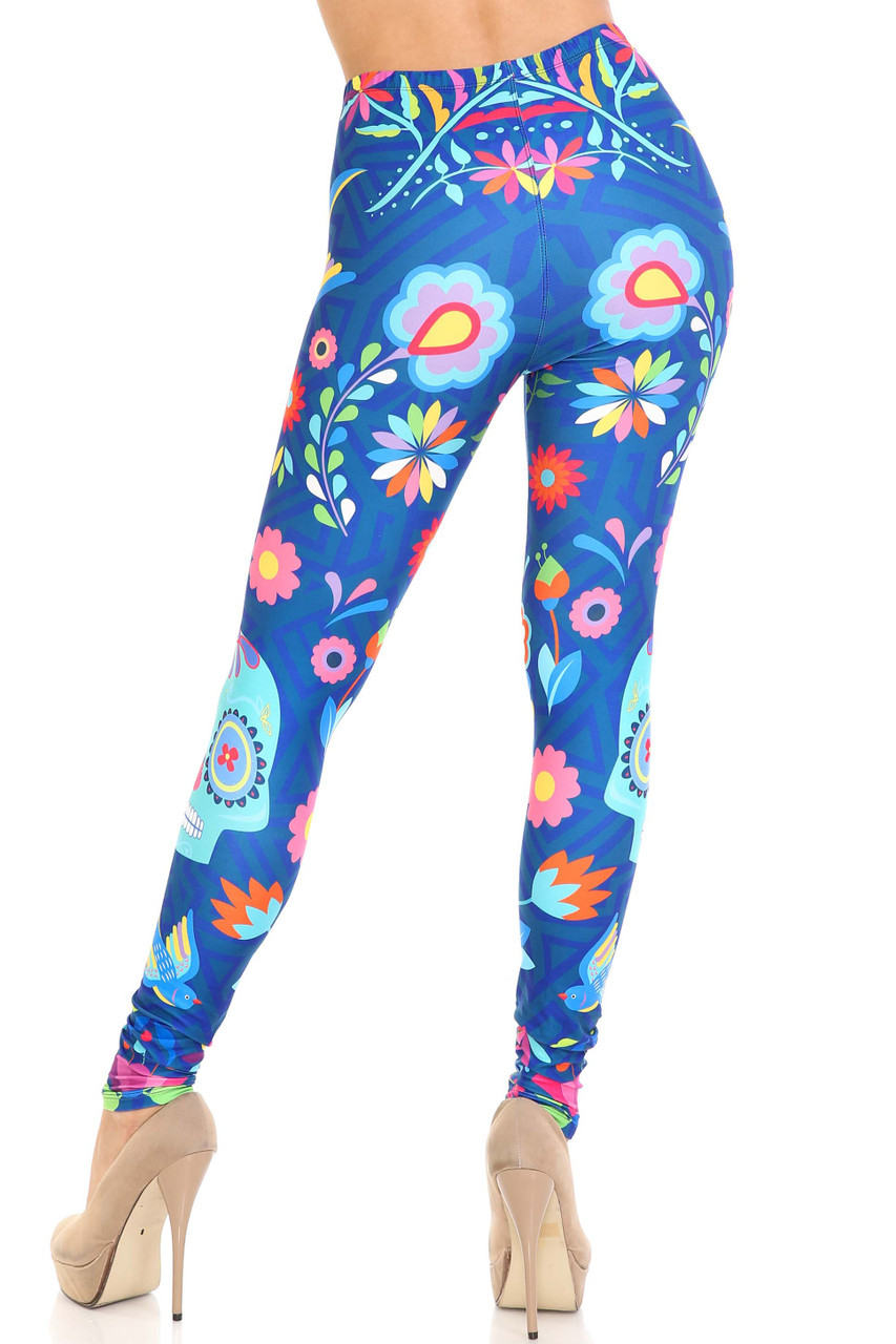 Rear view image of Creamy Soft Garden of Eden Sugar Skull Plus Size Leggings - USA Fashion™ showcasing the fabulous figure flattering fit.