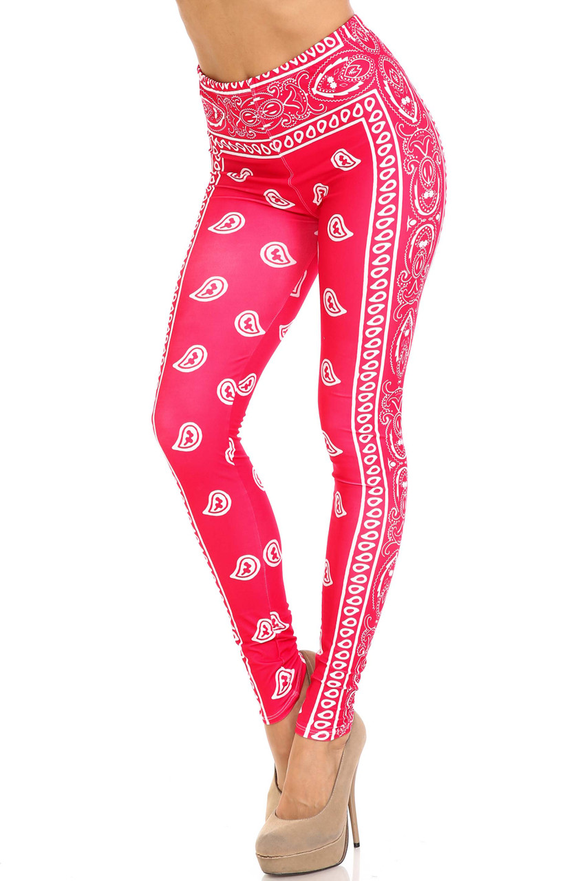 45 degree view of Creamy Soft Red Bandana Plus Size Leggings - USA Fashion™  featuring a red and white paisley design.