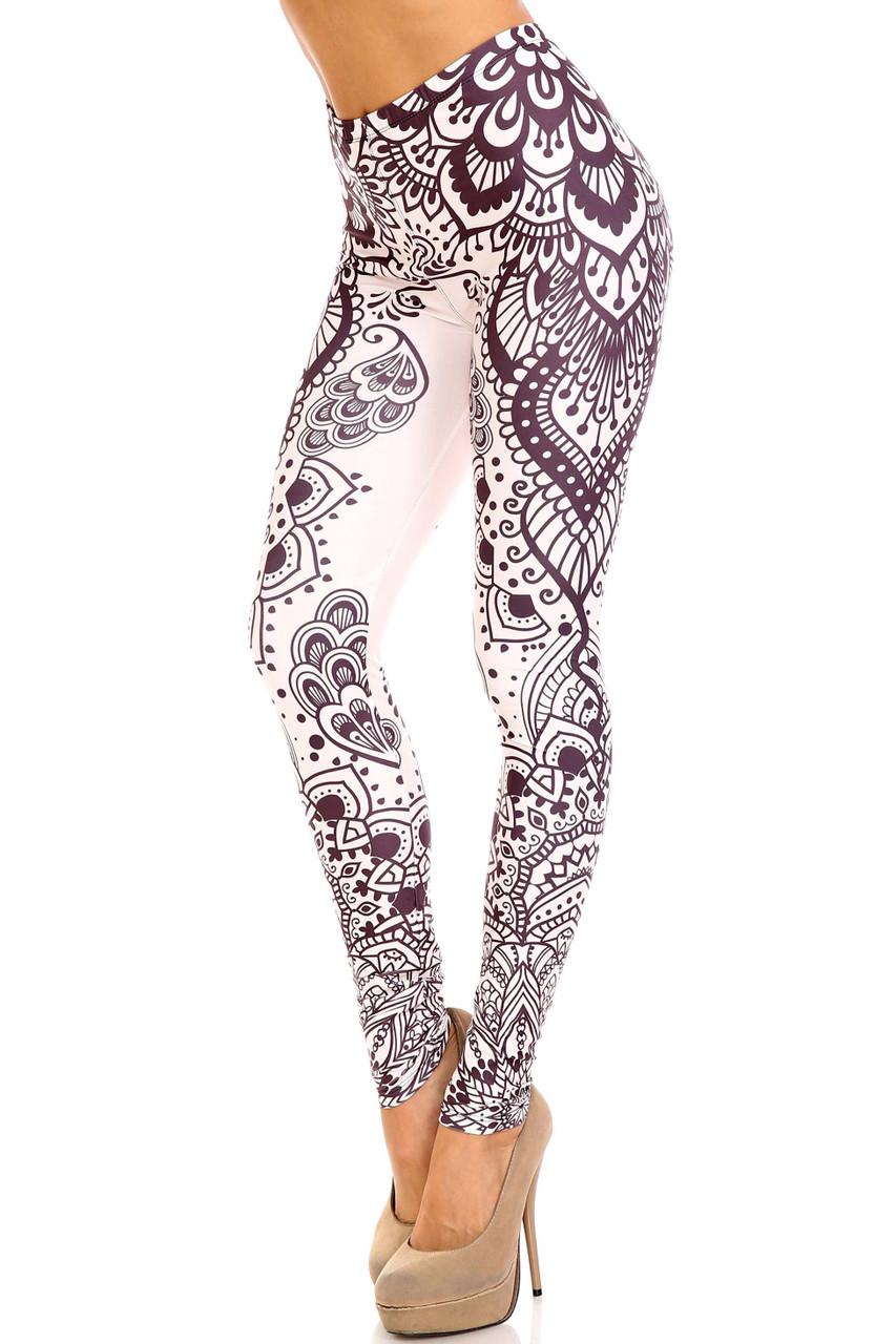 45 degree view of Creamy Soft Creamy Tribal Mandala Plus Size Leggings - USA Fashion™ with a stunning neutral toned beige and black mandala design.