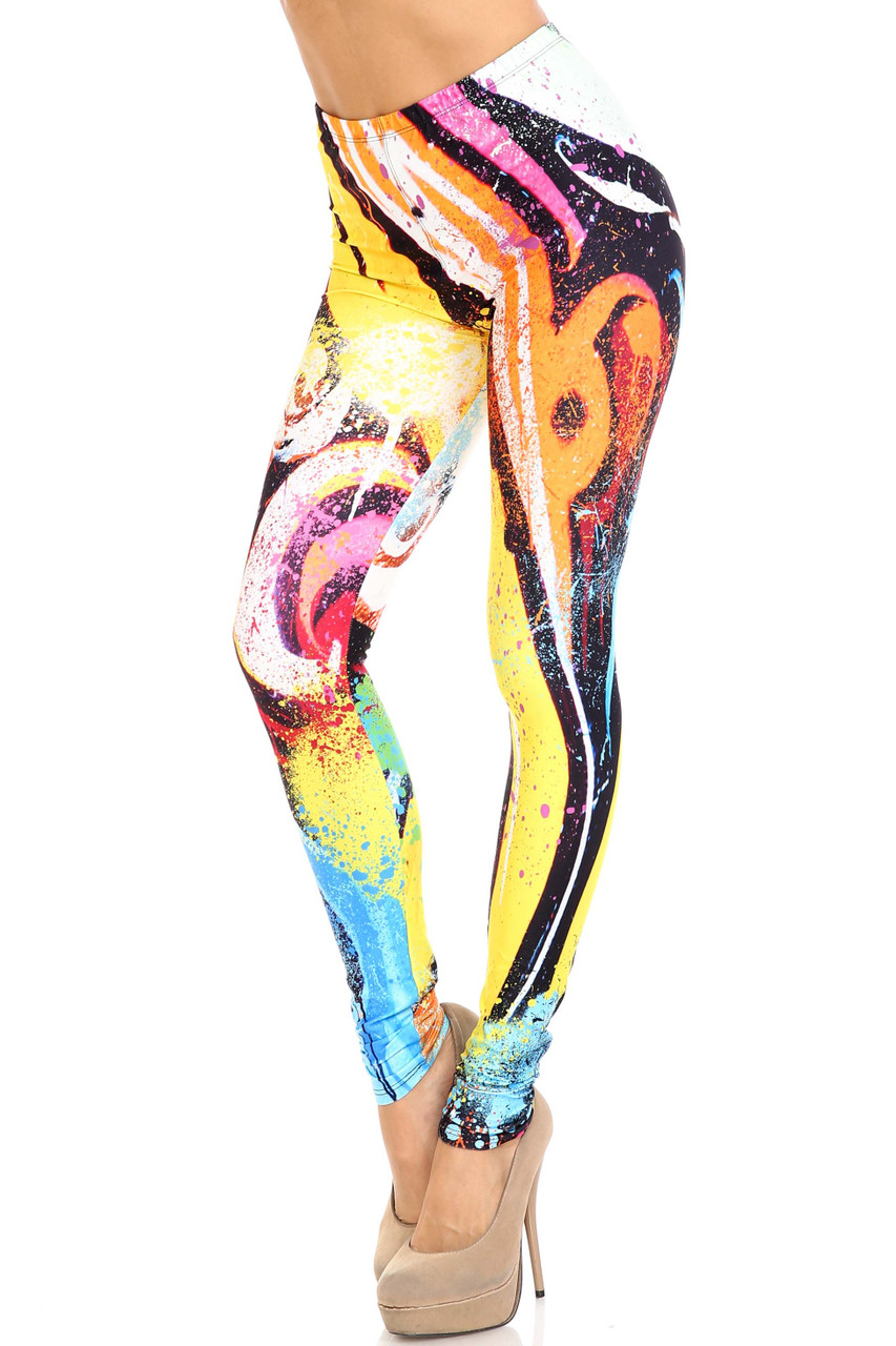 45 degree view of Creamy Soft Colorful Paint Strokes Plus Size Leggings - USA Fashion™ with an all over super colorful painted design.