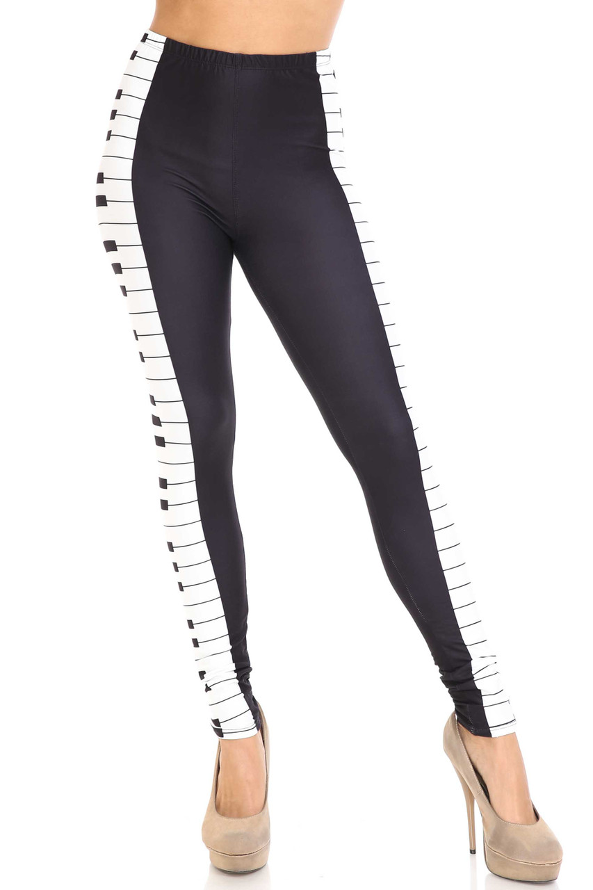 Front view of mid rise Creamy Soft Keys of the Piano Leggings - USA Fashion™ with an elastic banded waist.