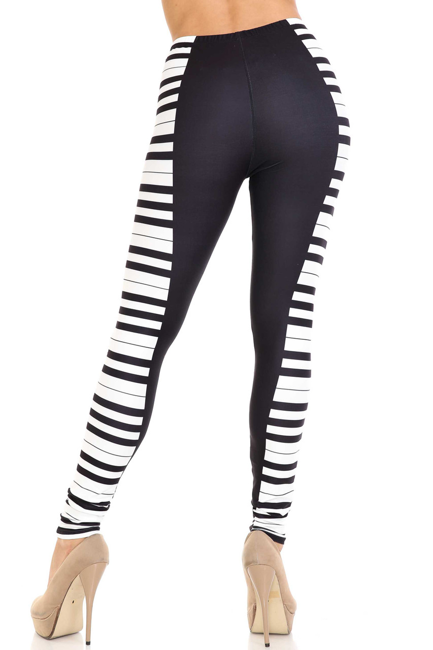 Rear view of Creamy Soft Keys of the Piano Plus Size Leggings - USA Fashion™ showing off a figure flattering fit.