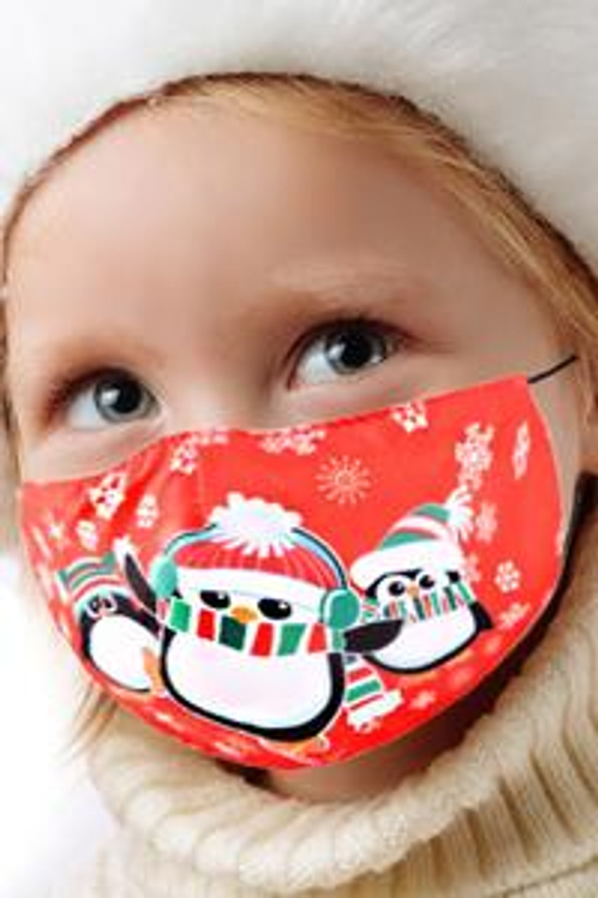 45 degree view of Red Kids Christmas Penguins Face Mask with an adorable festive cartoon design featuring three penguins in winter clothing.