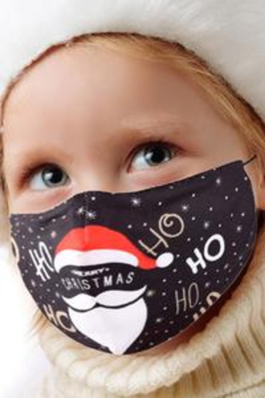 45 degree view of Ho Ho Santa Beard and Hat Kids Christmas Face Mask showcasing a fabulous Santa Claus themed holiday design.