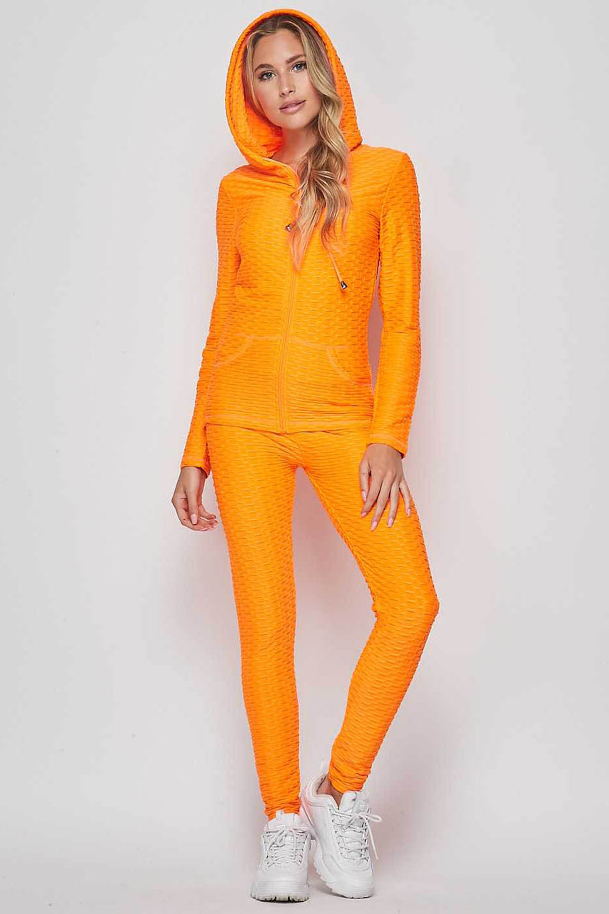 Front view of Neon Orange 2 Piece Scrunch Butt Leggings and Hooded Jacket Set