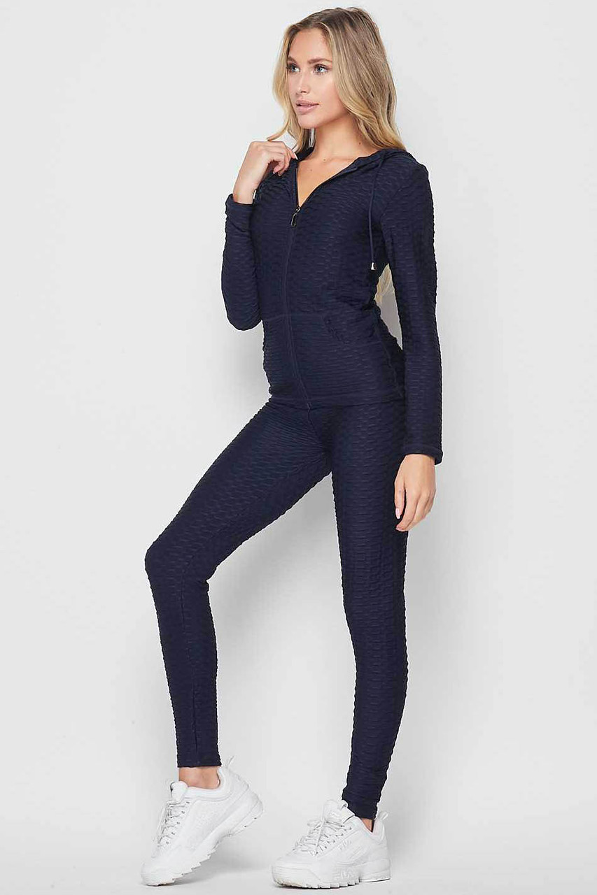 45 degree front view of Navy 2 Piece Scrunch Butt Leggings and Hooded Jacket Set