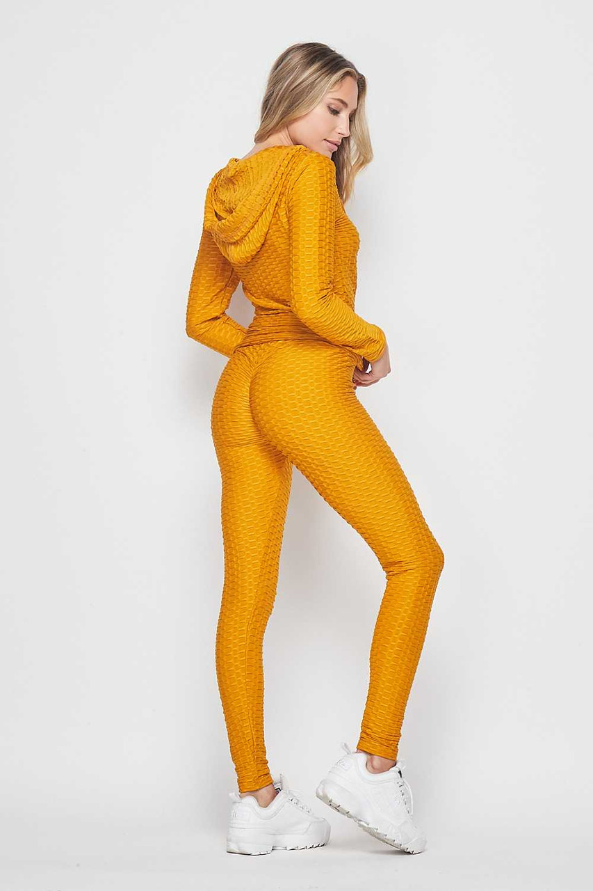 45 degree back view of Mustard 2 Piece Scrunch Butt Leggings and Hooded Jacket Set