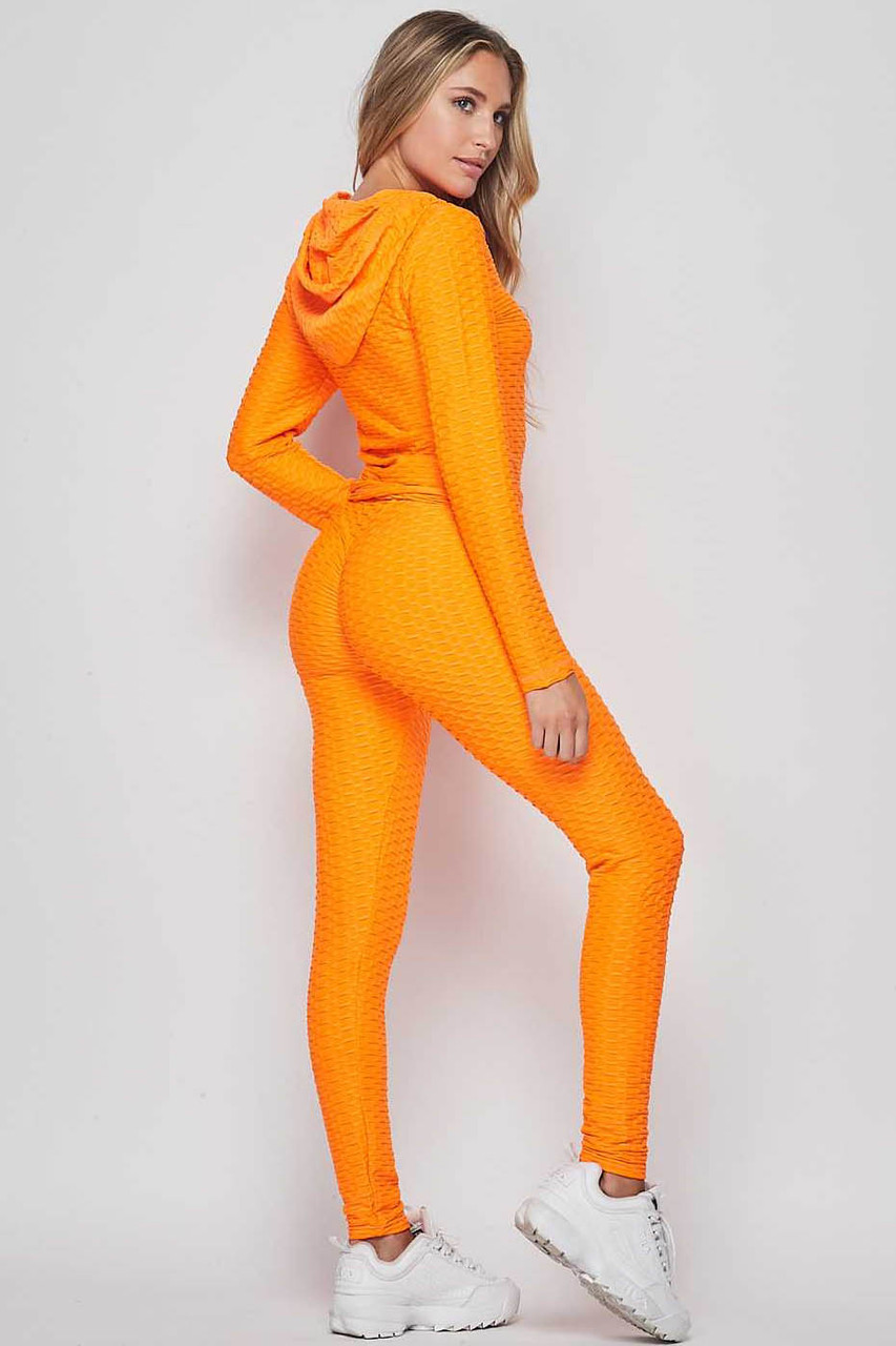 45 degree back view of Neon Orange 2 Piece Scrunch Butt Leggings and Hooded Jacket Set