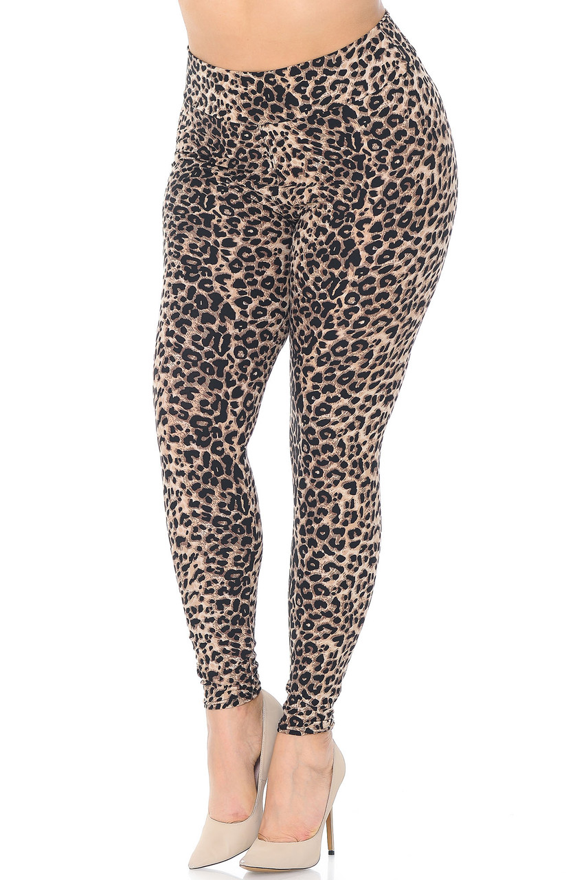 45 degree view of Buttery Soft Feral Cheetah Plus Size High Waisted Leggings with an all over spotted animal print design.