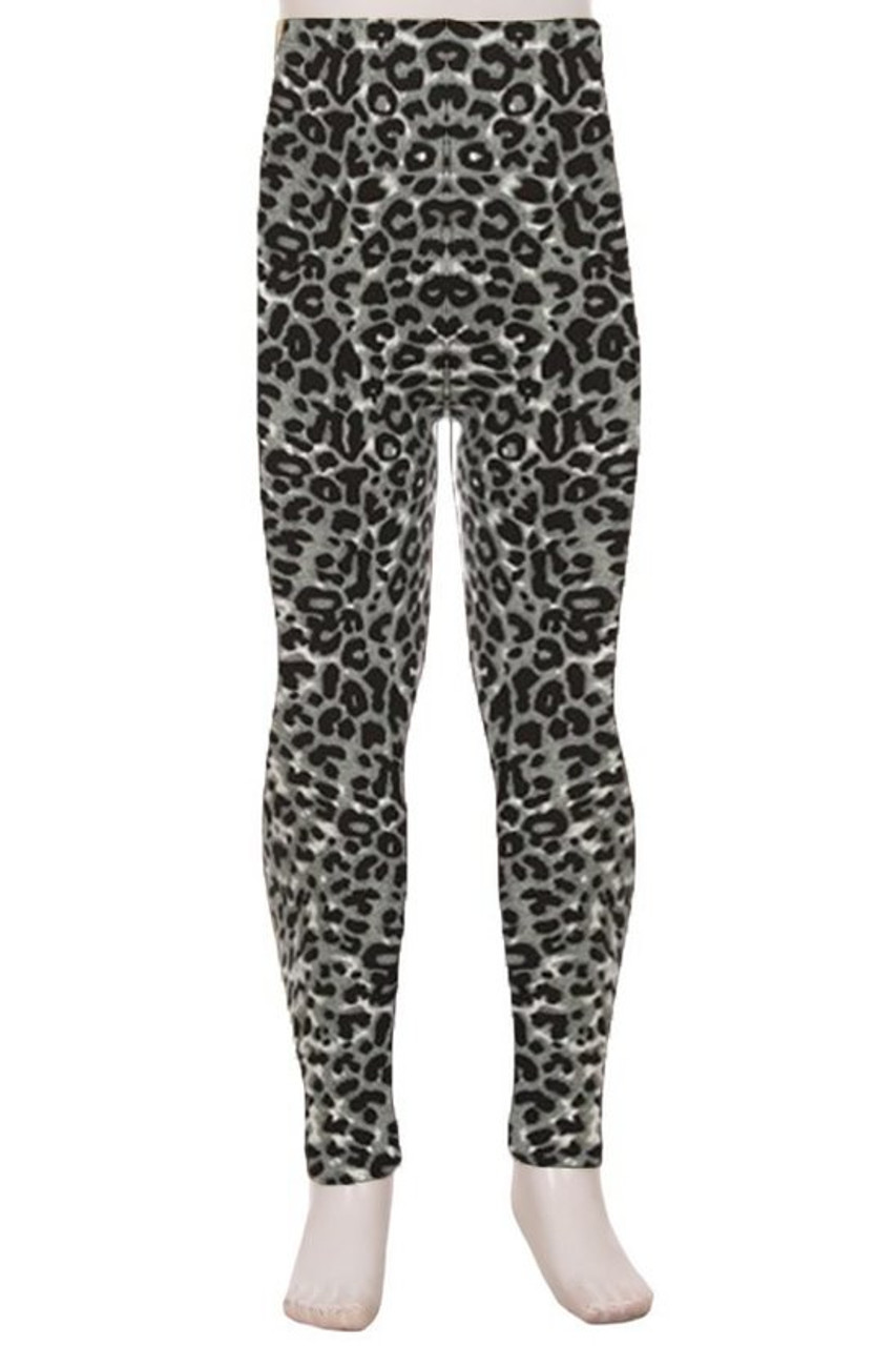 Front view of Buttery Soft Snow Leopard Kids Leggings with a versatile black and white animal print design.