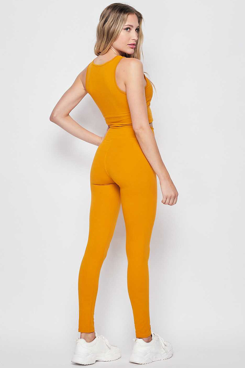 45 degree rear view of Mustard Buttery Soft High Waisted 3 Inch Leggings and Crop Top Bra Set