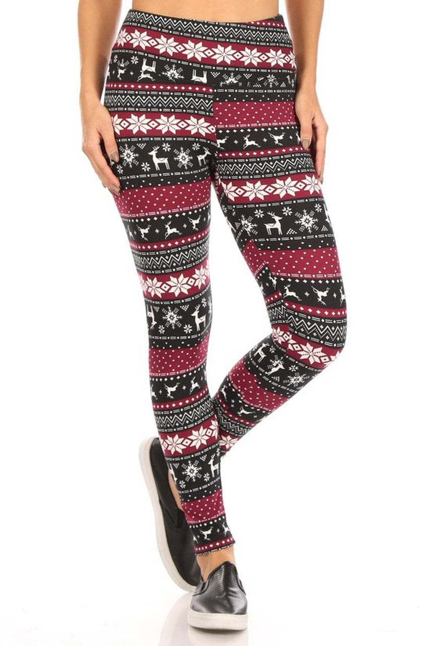 Front view of Soft Fleece Beautiful Burgundy Reindeer and Snowflake Leggings with a fair isle style snowflake and reindeer design.