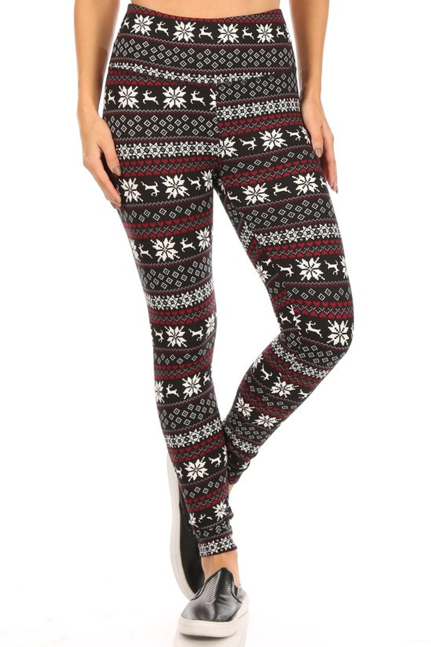 Front view of Soft Fleece Reindeer Dashing Through the Snow Holiday Leggings with a festive fair isle reindeer and snowflake design.