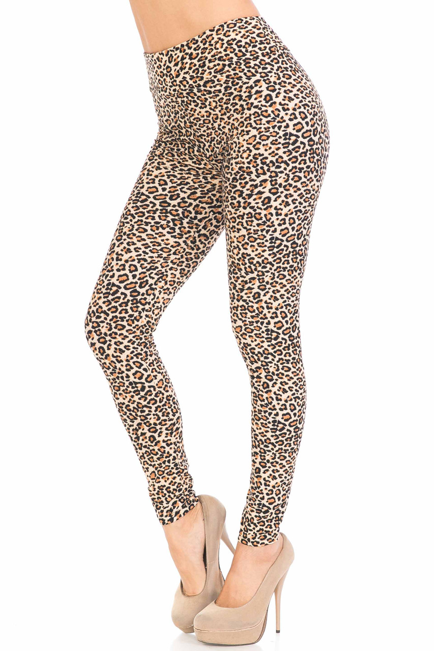 Left side view of Buttery Soft Savage Leopard High Waisted Leggings with an all over spotted beige, brown, and black animal print design.