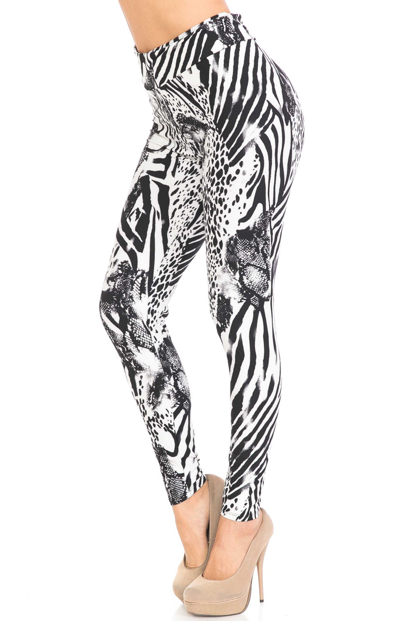 Left side image of Buttery Soft Wild Safari Plus Size High Waisted Leggings featuring a black and white mixed animal print and reptile design.