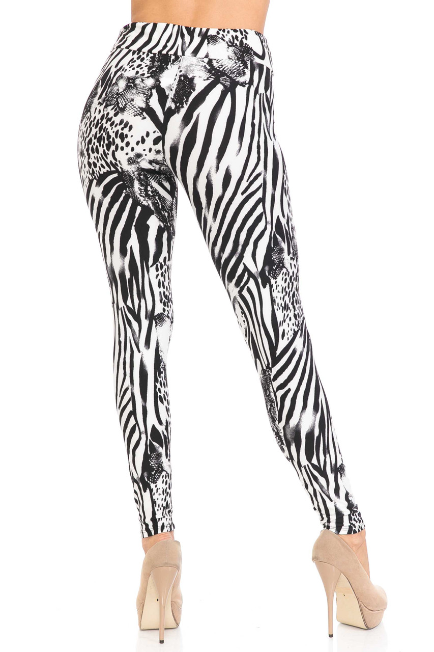 Rear view of Buttery Soft Wild Safari Plus Size High Waisted Leggings showing the flattering body-hugging fit.