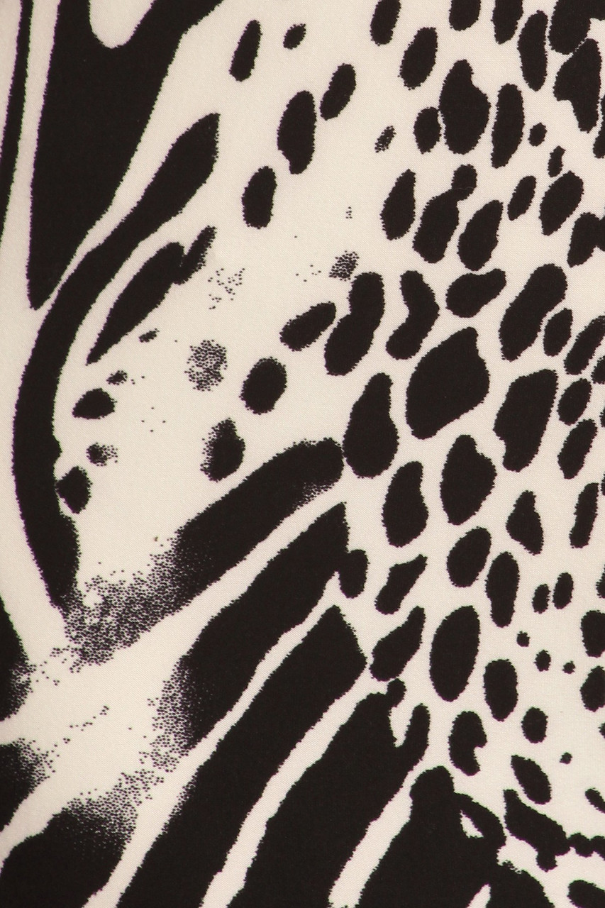Close up fabric swatch of Buttery Soft Wild Safari Plus Size High Waisted Leggings