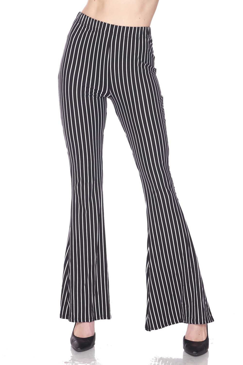 Front view of Buttery Soft Pinstripe Bell Bottom Leggings featuring a versatile thing vertical striped design in a black and white color scheme.