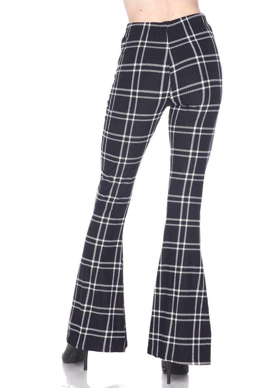 Rear view of Buttery Soft Midnight Dashed Plaid Bell Bottom Leggings with a fashionable flared leg cut.