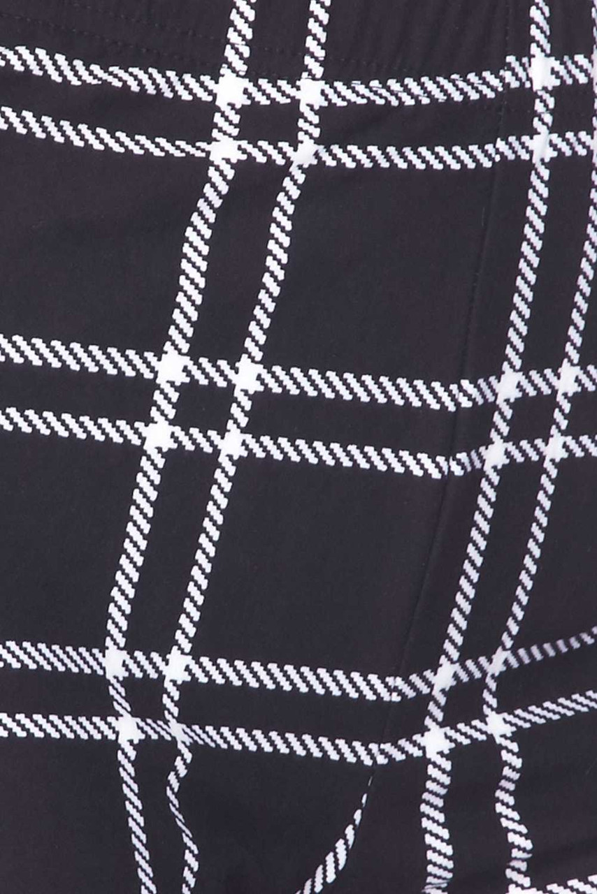 Close-up fabric swatch of Buttery Soft Midnight Dashed Plaid Bell Bottom Leggings